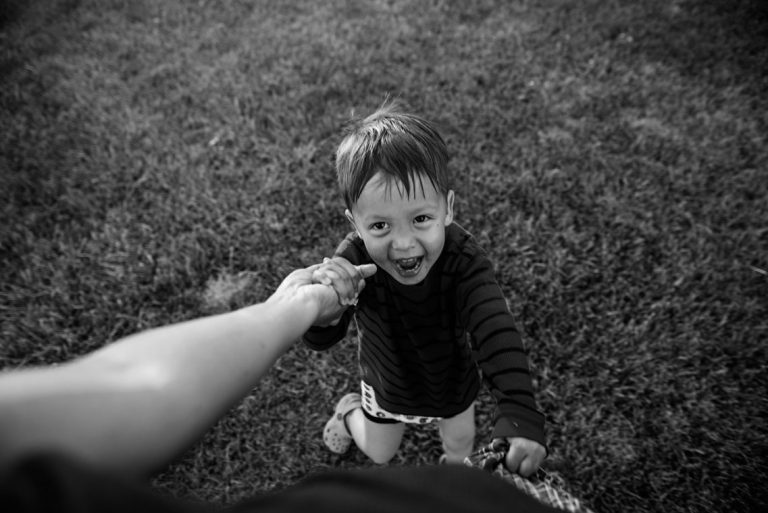 boy laughing holding hands