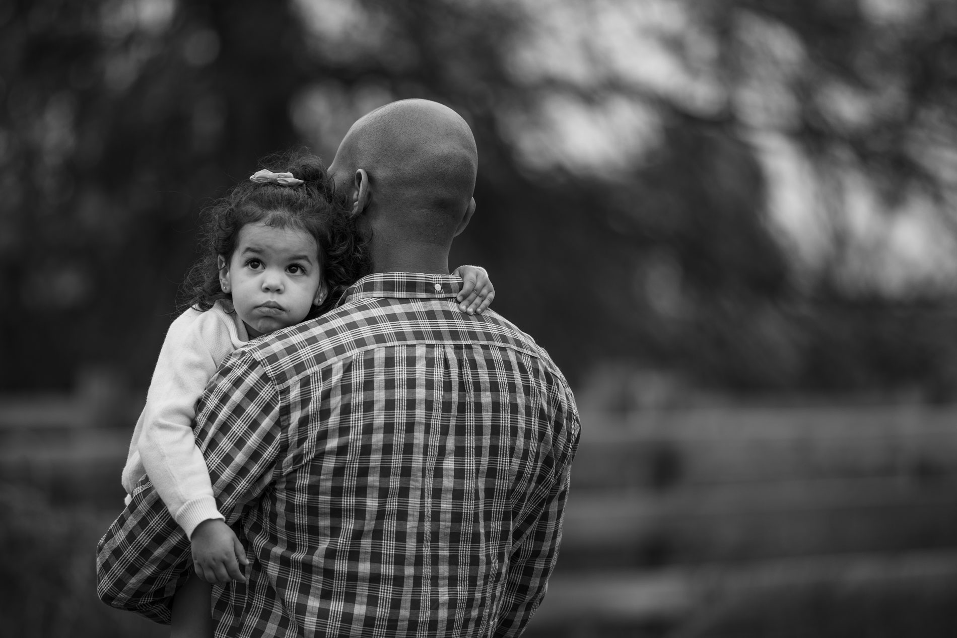 girl carried by dad