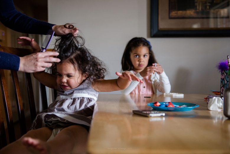 mother brushing babys hair spokane photographer