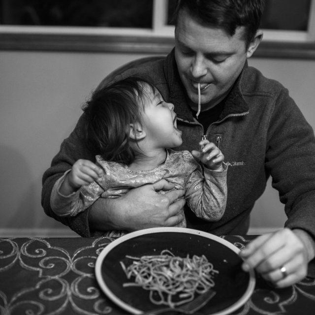 toddler stealing dad food