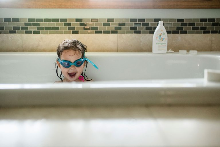 girlw ith goggles on in bath