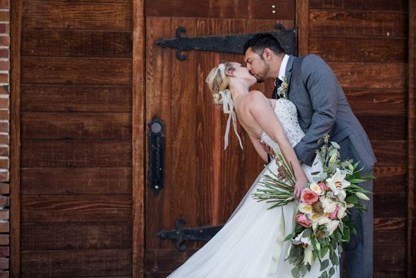 groom-tipping-bride-kiss-spokane-wedding-photographer