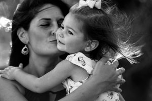 mommy kissing daughter