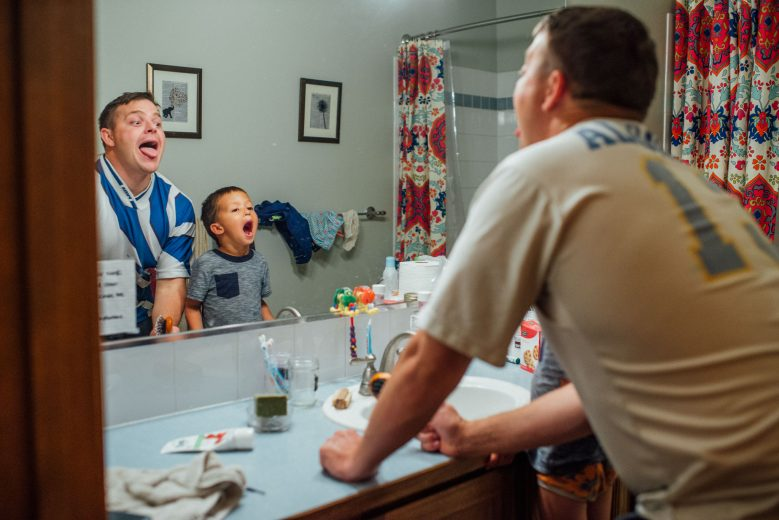 Boy and dad checking their teeth are clean | Spokane Family Photographer