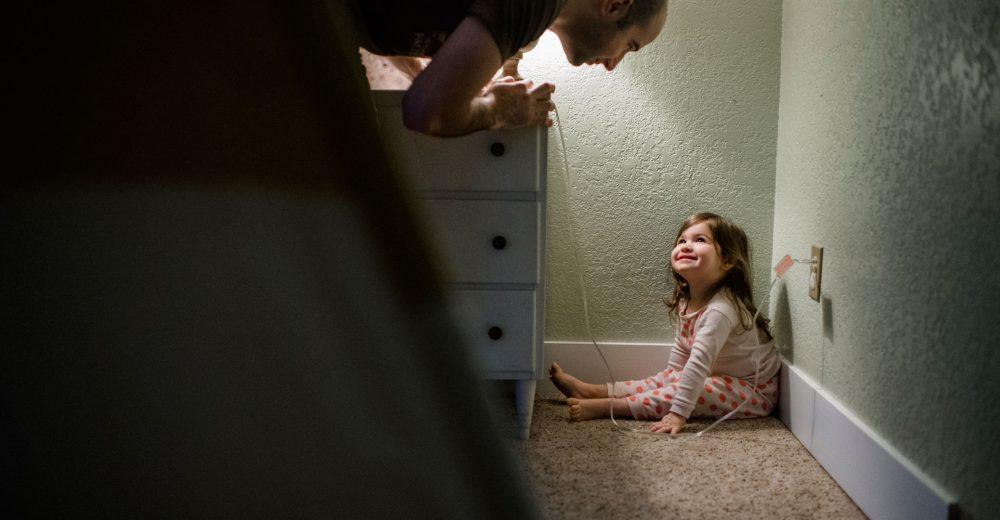 daddy finding little girl hiding