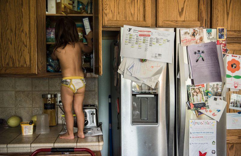 girl raiding cabinet for cookies