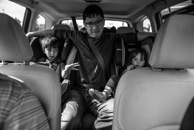 uncle stuck in back seat with neice and nephew