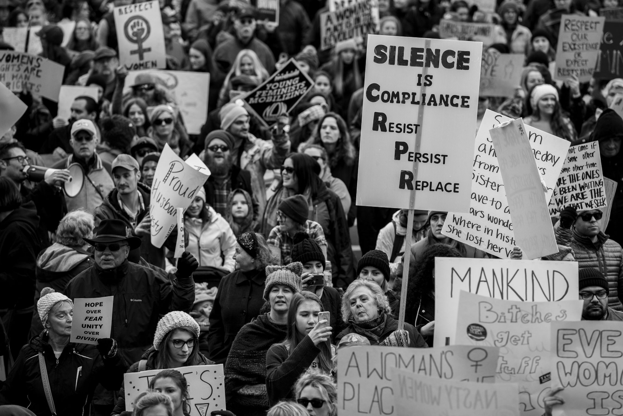 """silence is compliance"" sign"