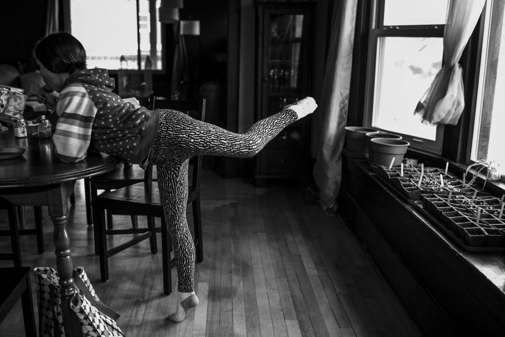 girl doing ballet in dining room