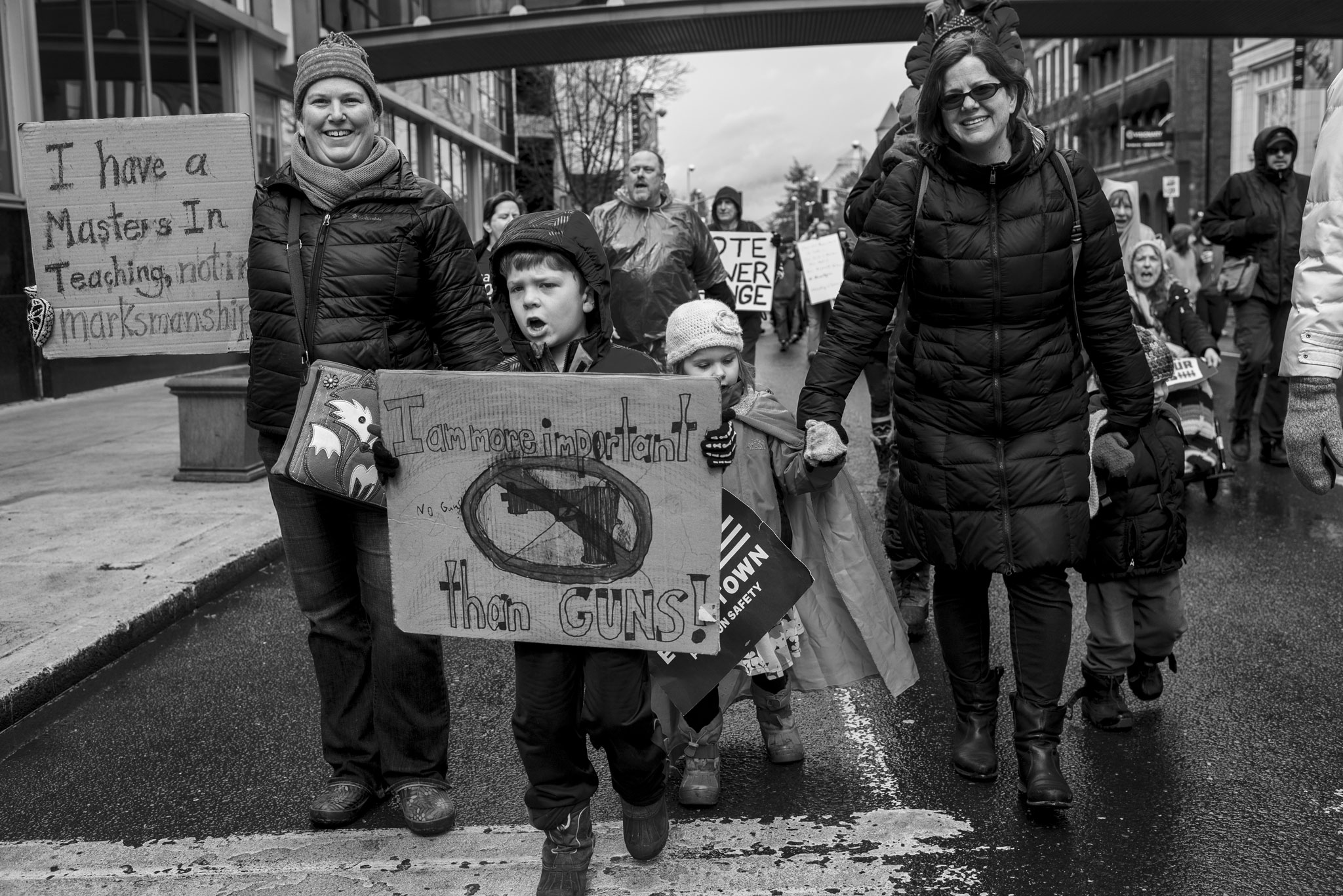 child marching with sign