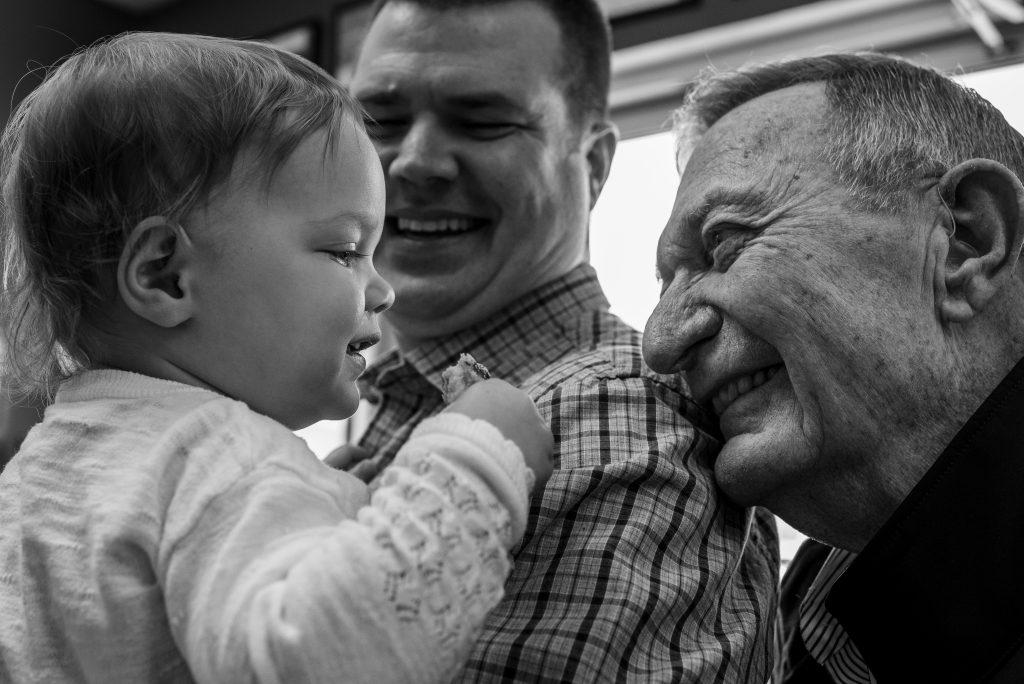 grandpa looking at baby