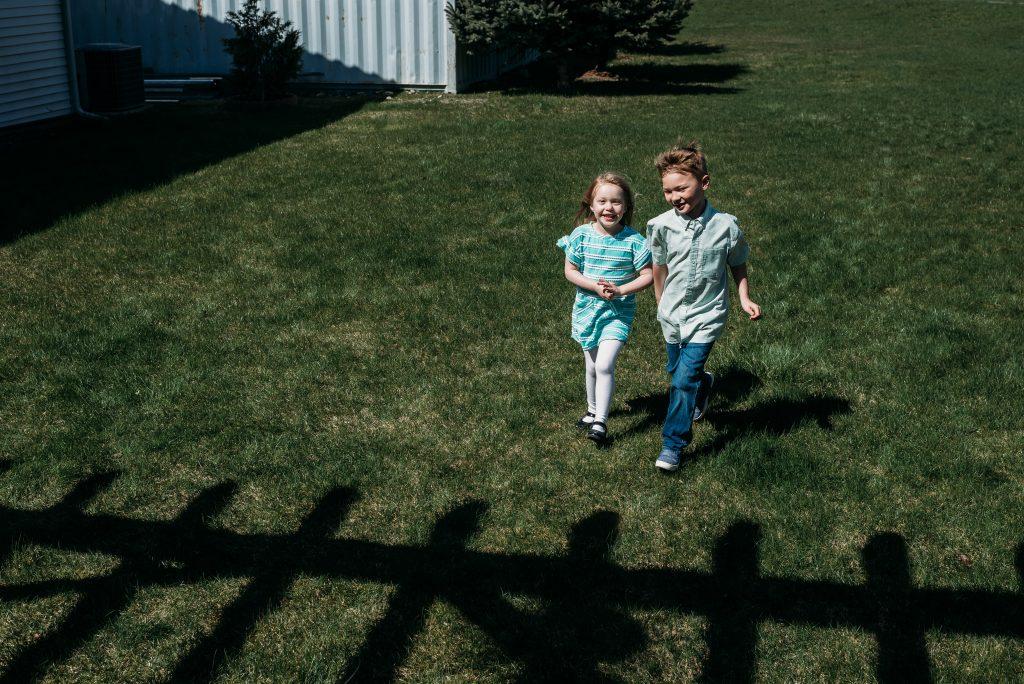 kids running on lawn