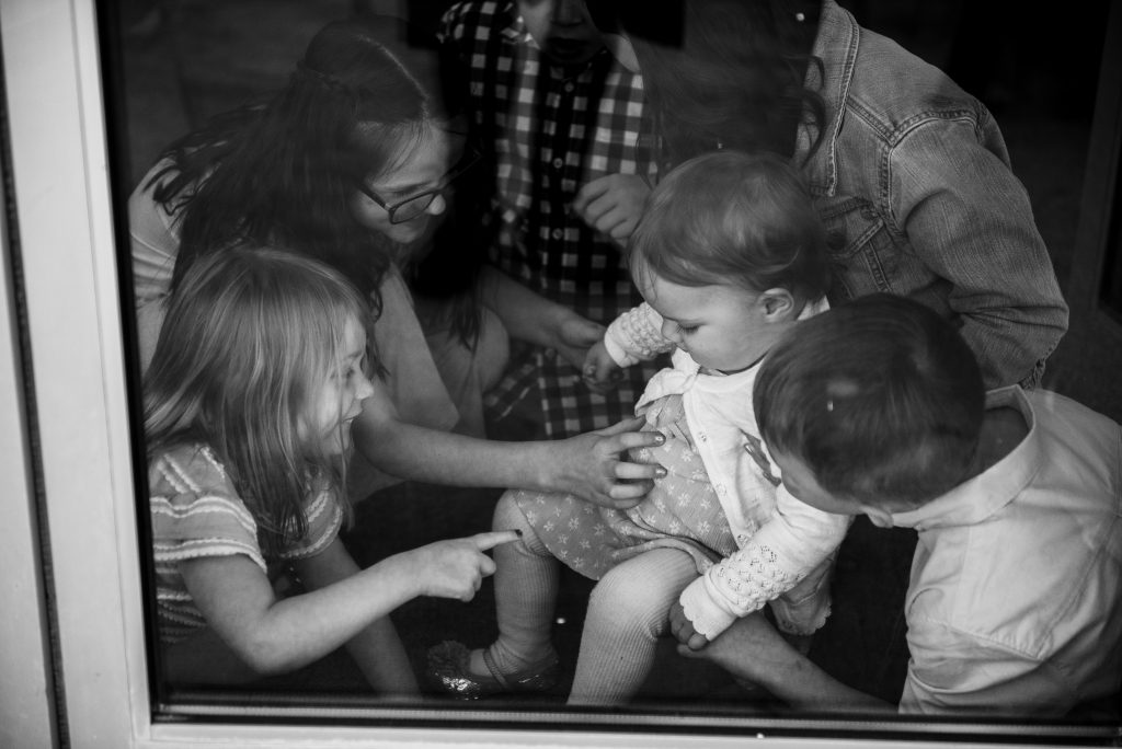kids playing with baby