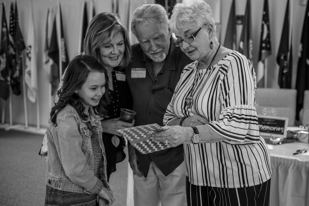 grandparents bragging about granddaughter