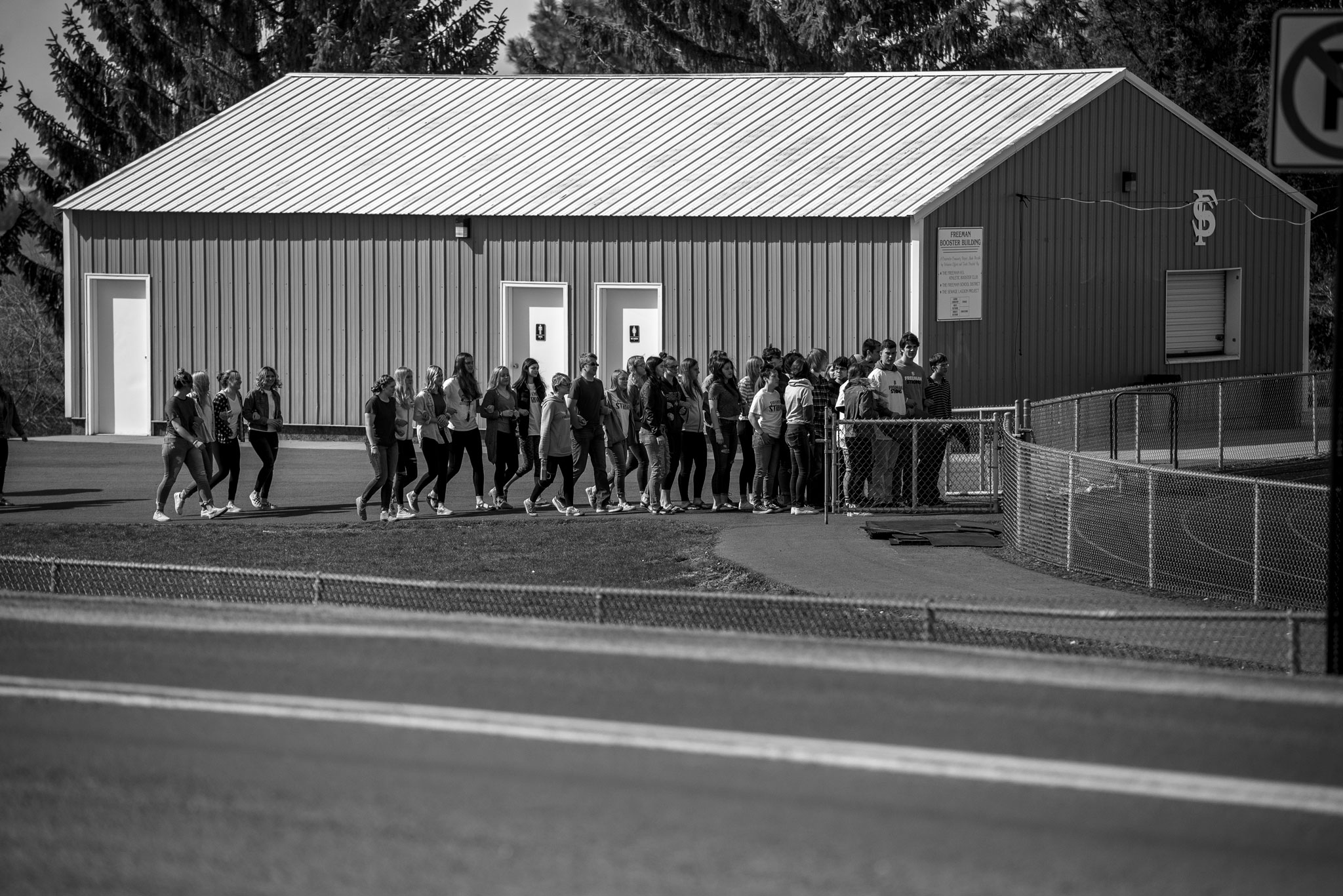 Freeman High School Walkout walking onto football field