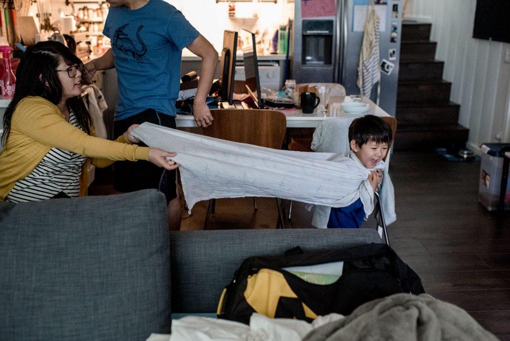 boy holding blanket cape