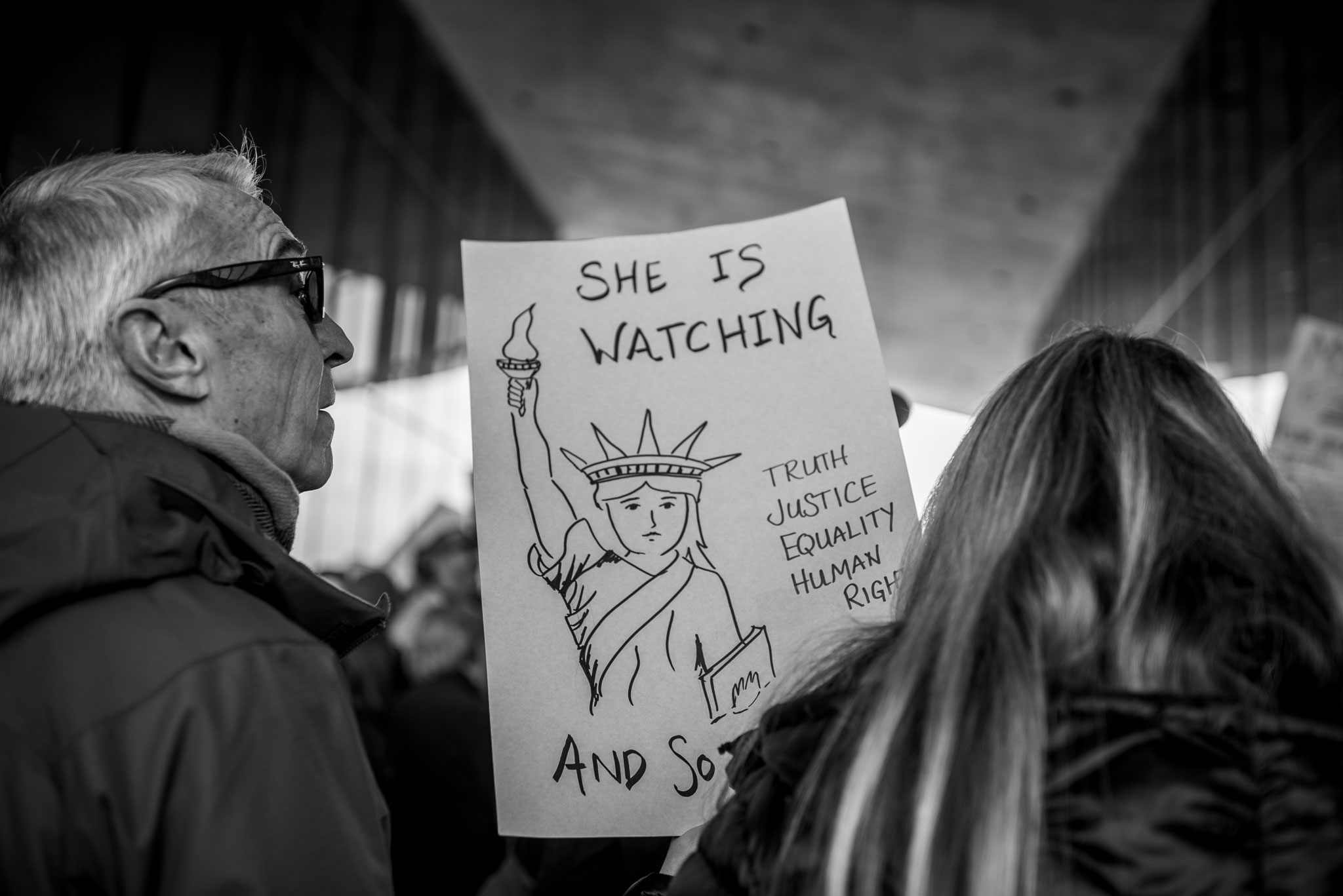 """She is Watching"" sign."