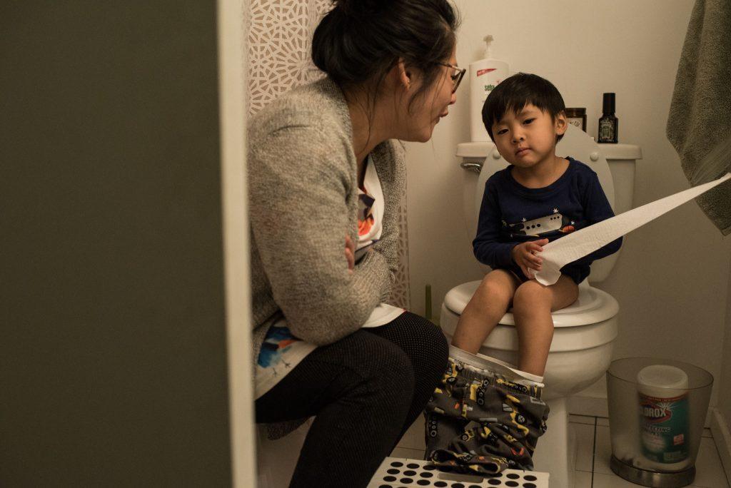 mom helping boy potty