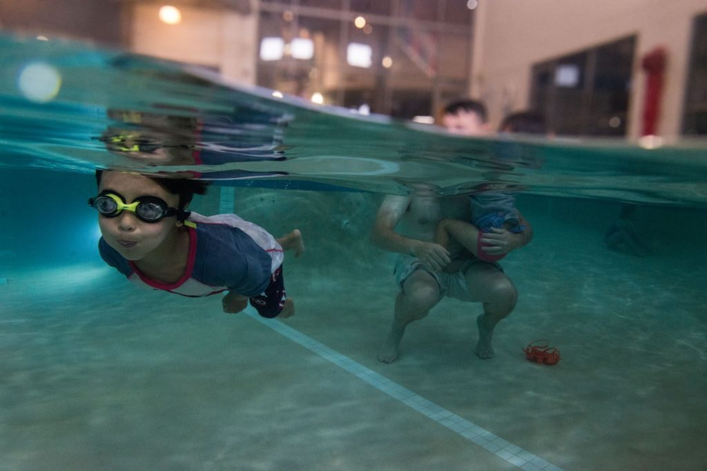 boy swimming towards camera