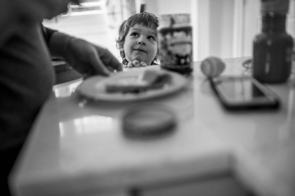 boy watching daddy make breakfast