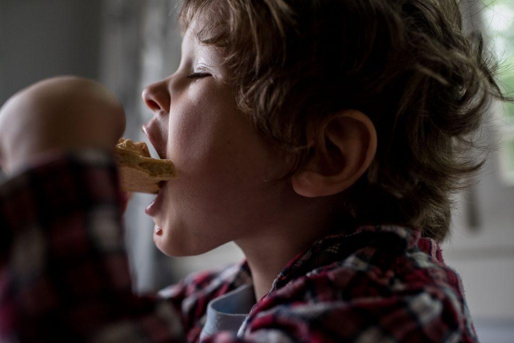 boy taking big bite