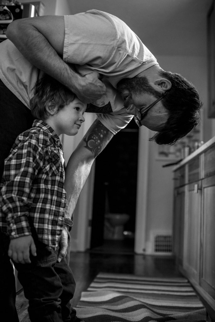 boy looking up at daddy