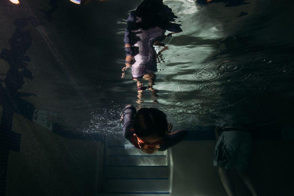 boy's reflection underwater