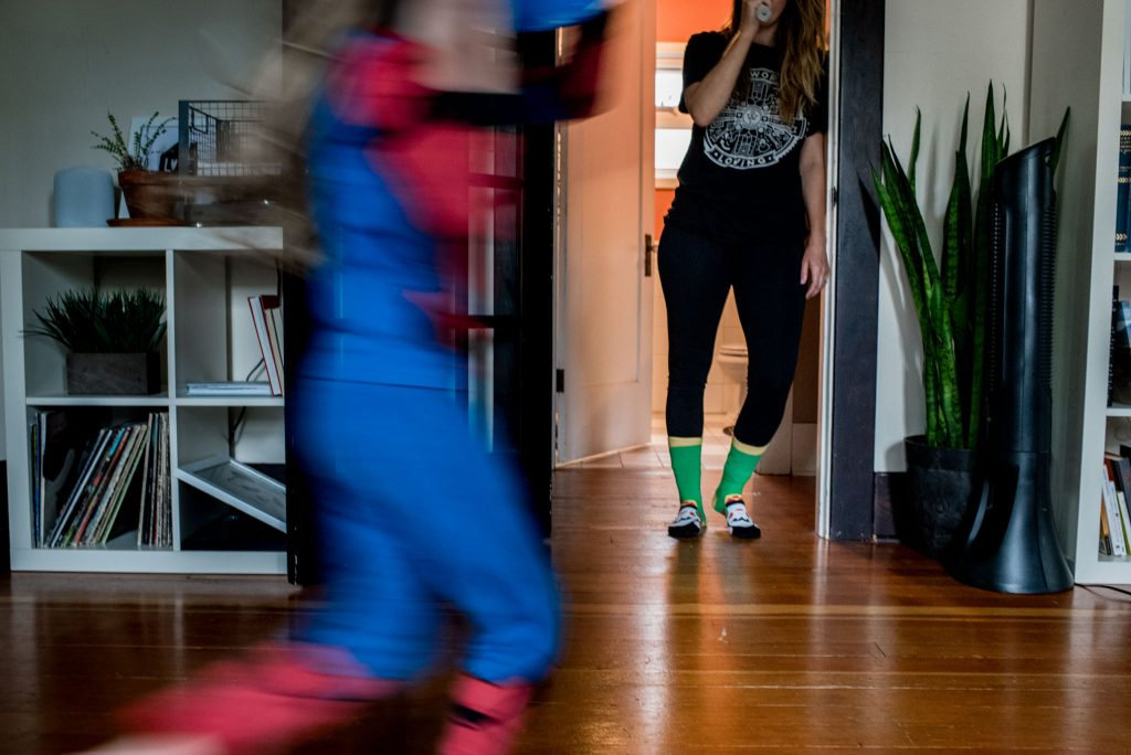girl running while mom brushes teeth