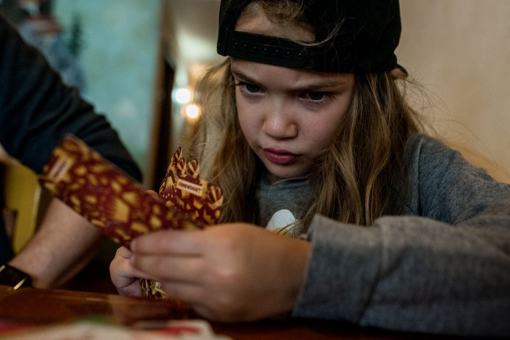 girl pouting over cards