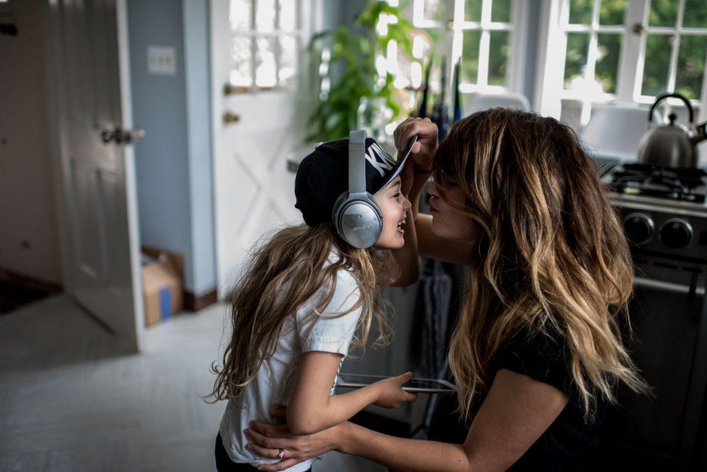 daughter giving mom kisses goodbye