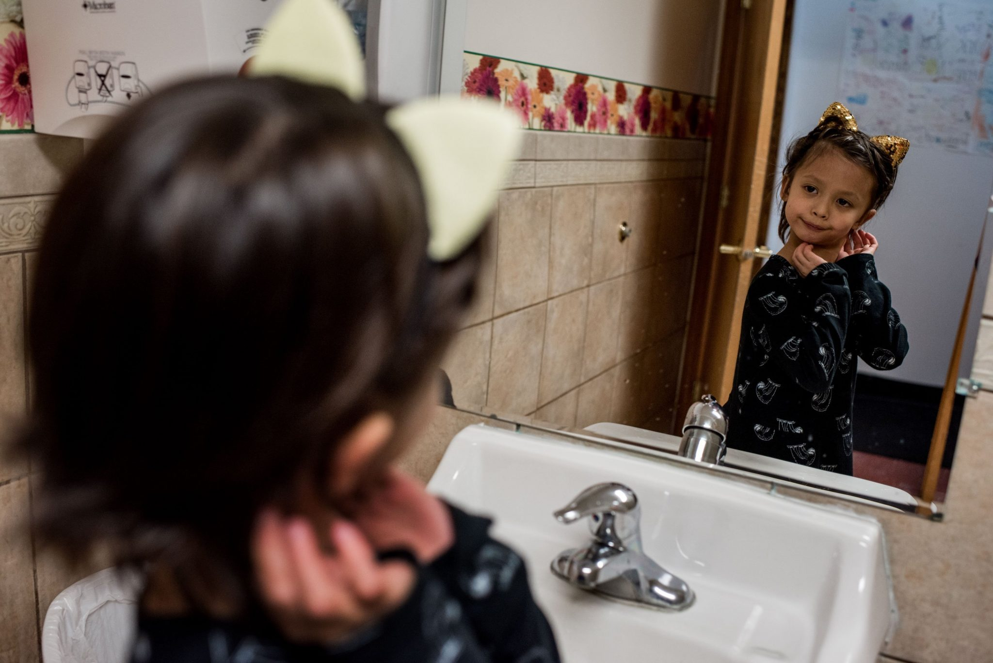 child looking in mirror