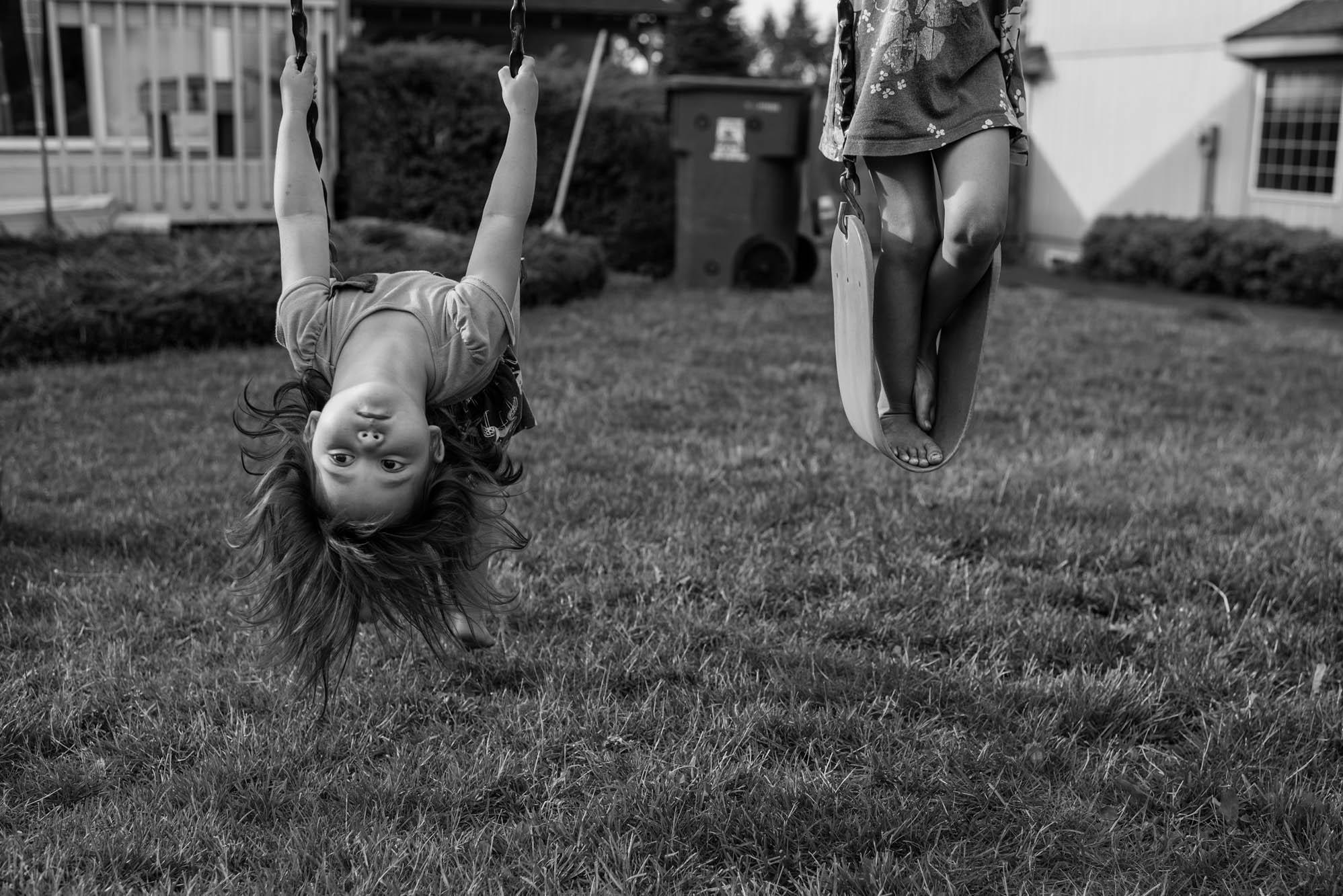 two girls on swings