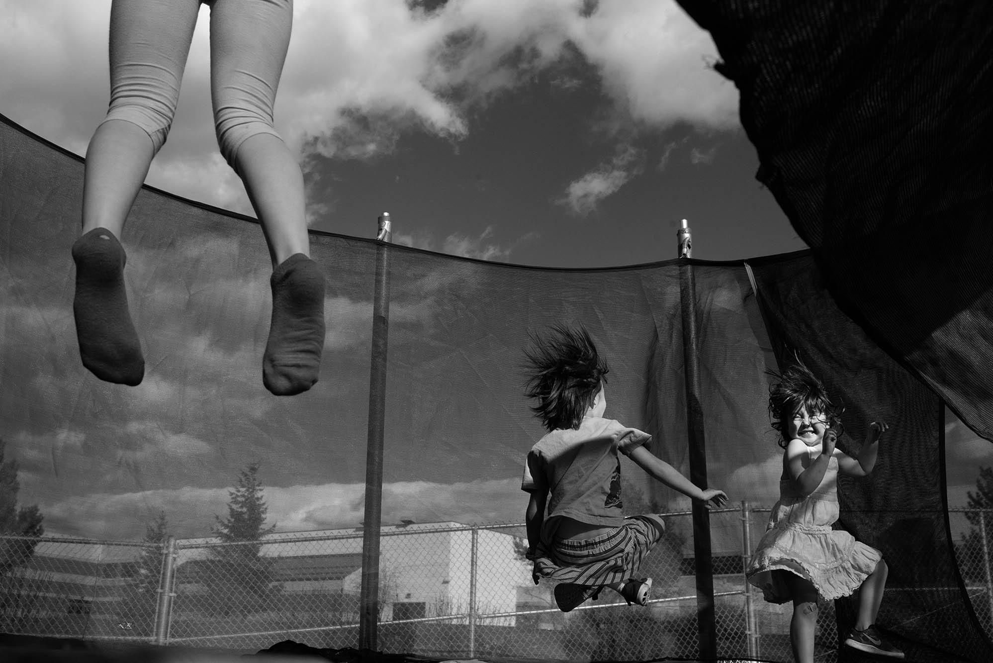 girls jumping on trampoline
