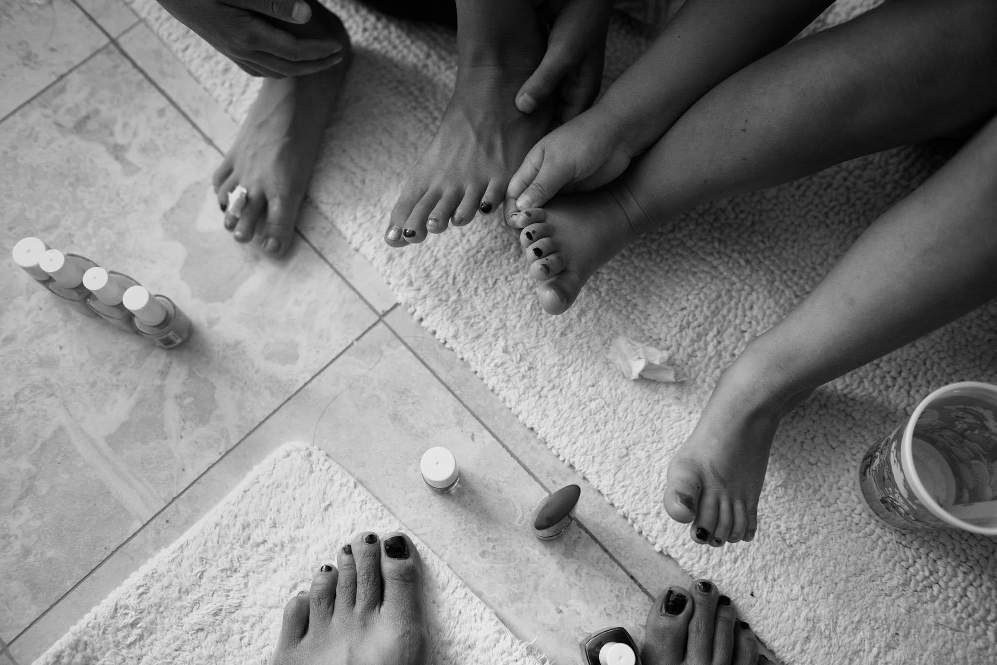 girls looking at painted nails