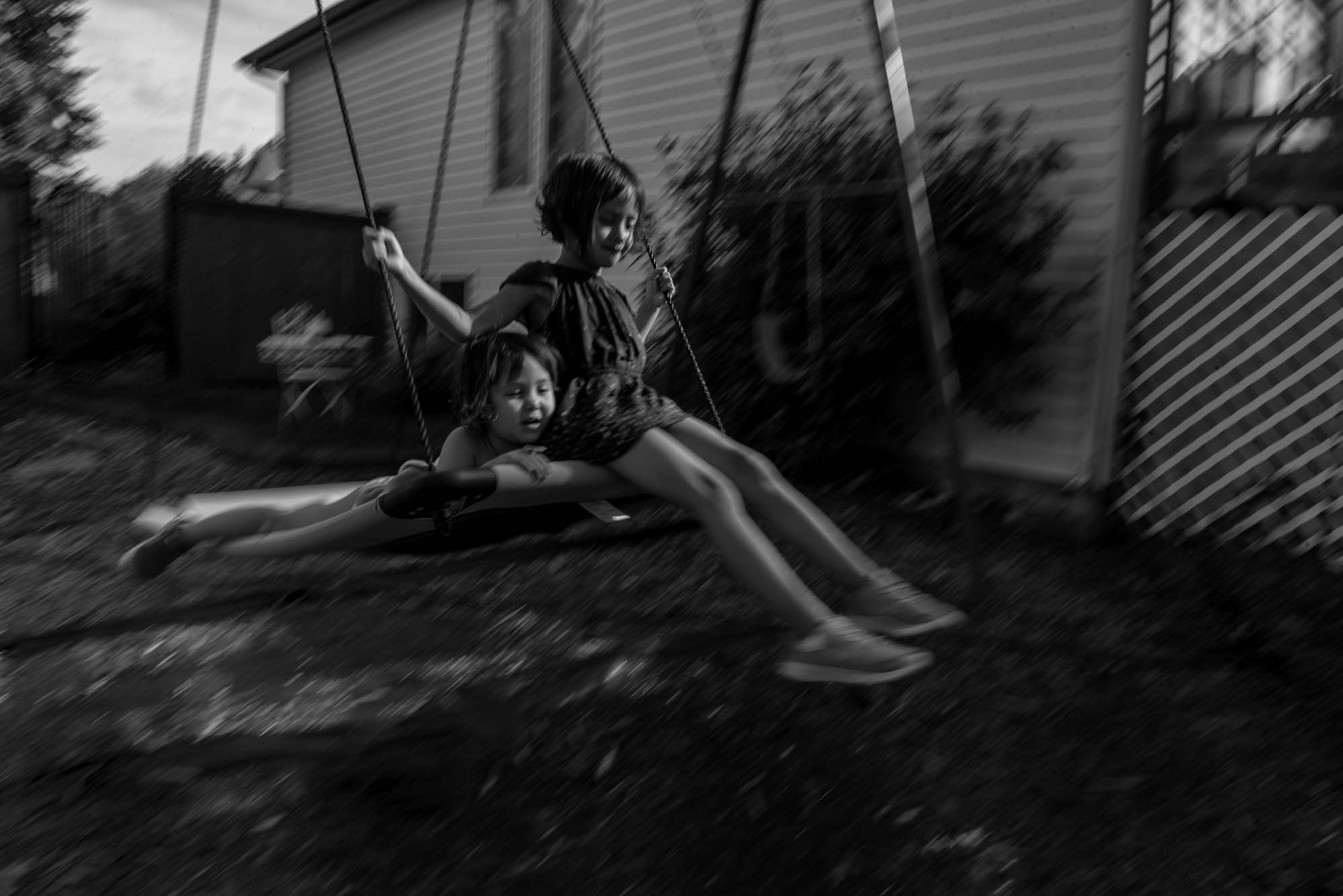 girls on swing together