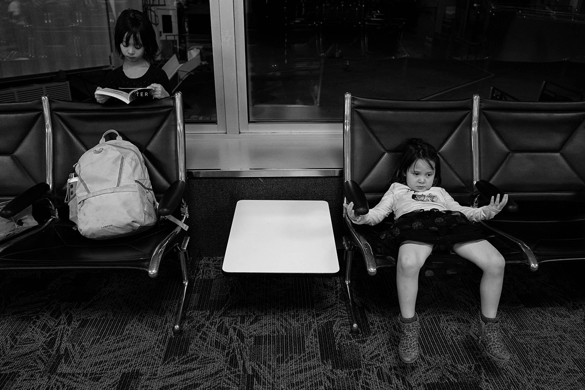 girls waiting in airport