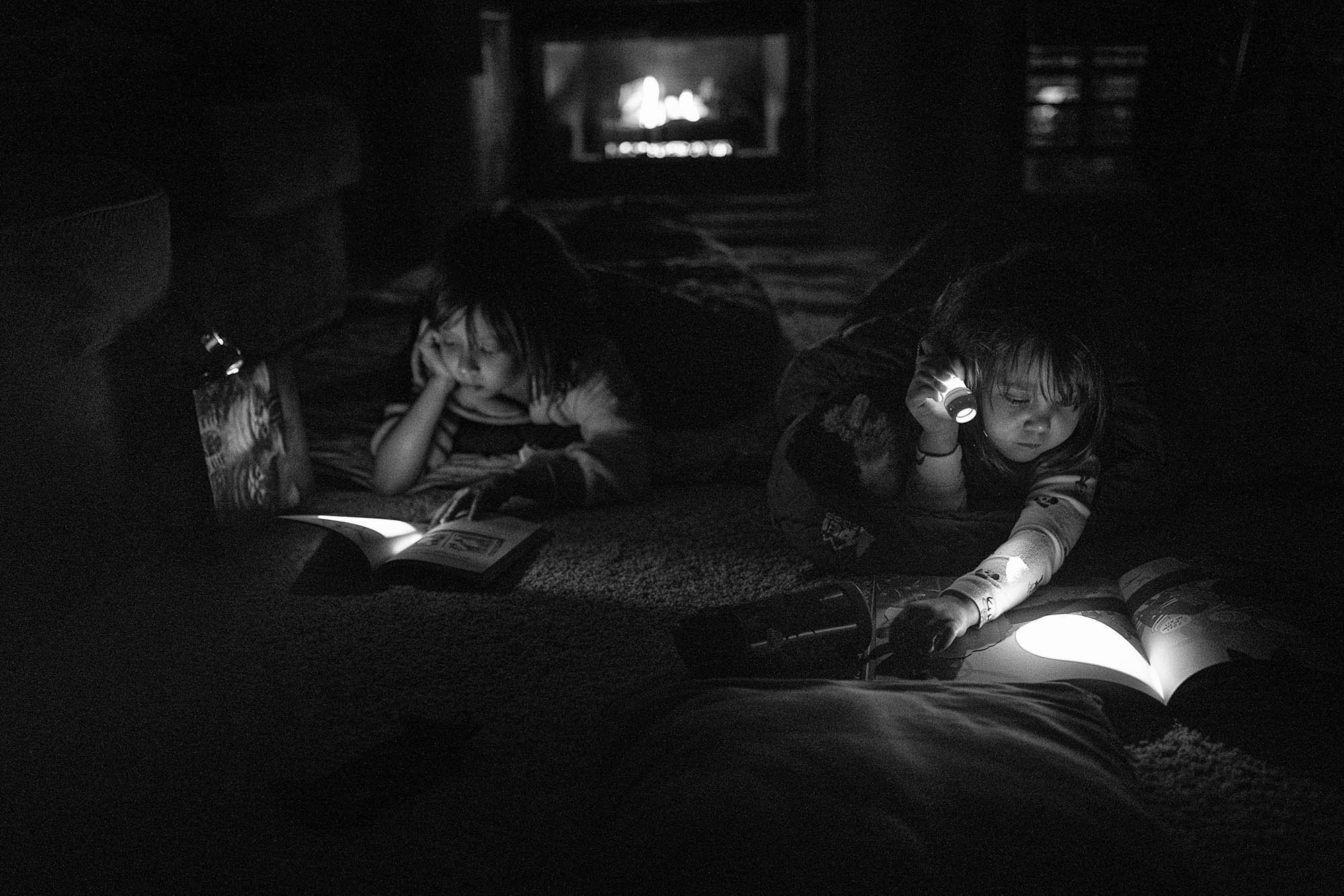 girls reading by the fire