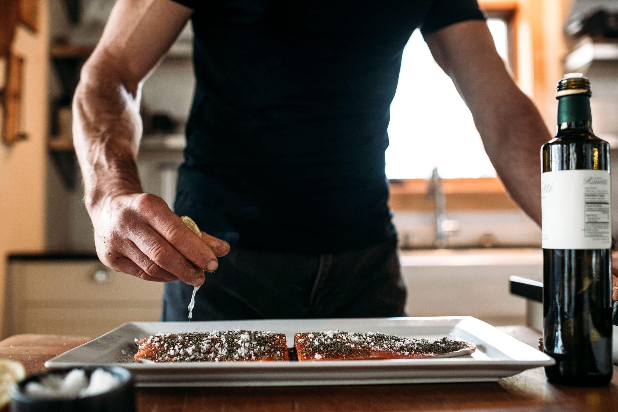 man cooking fish