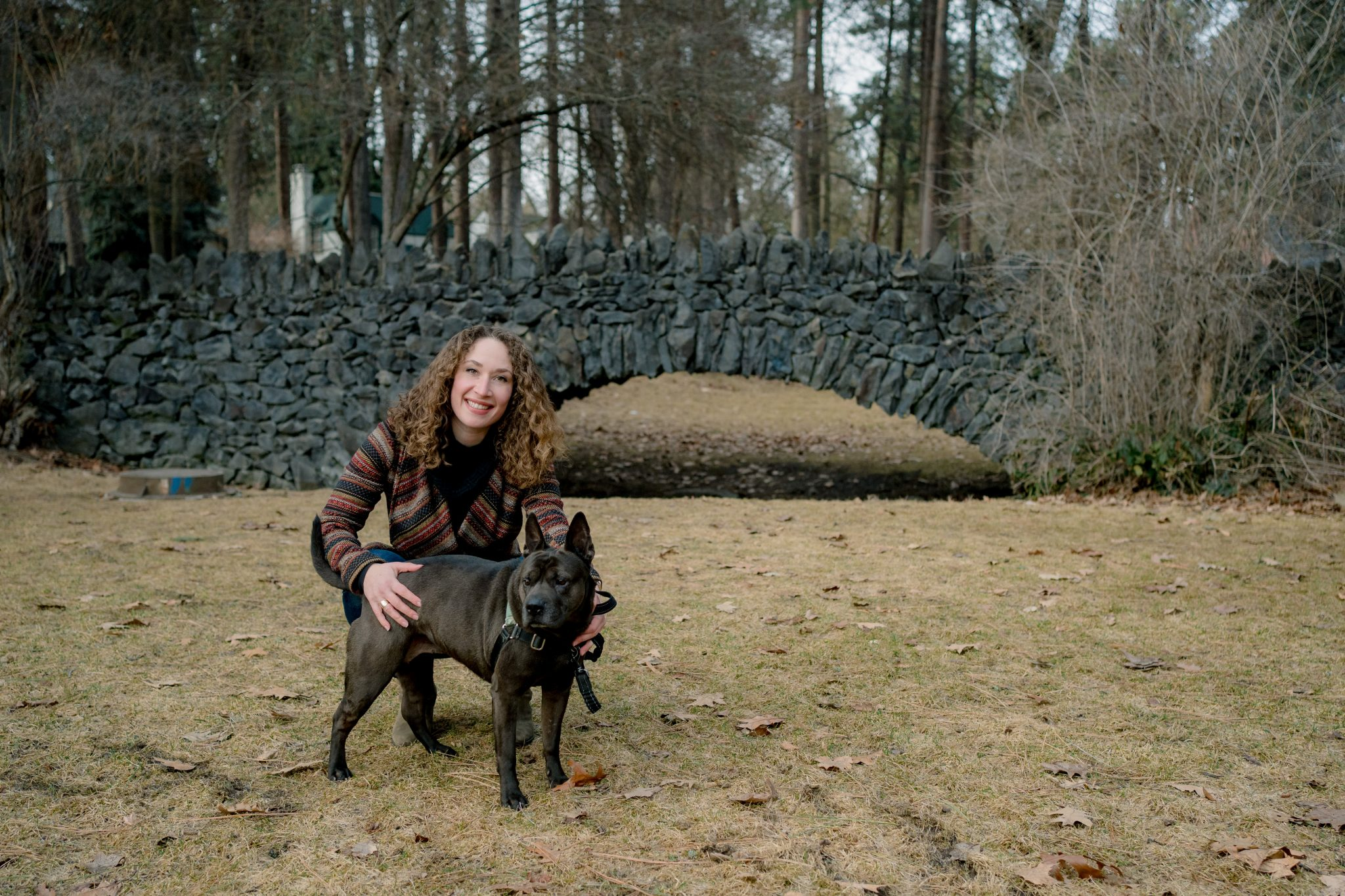 portrait of woman with dog in a park