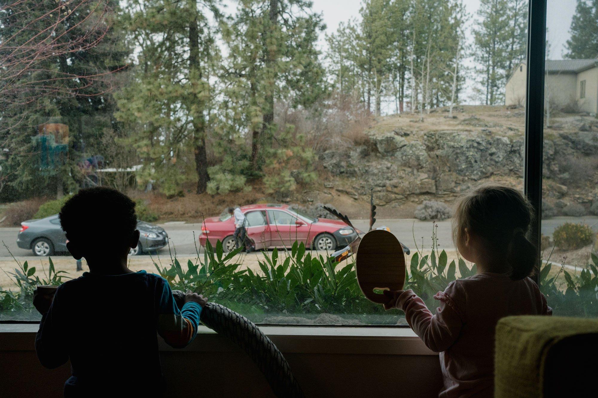 kids looking out window