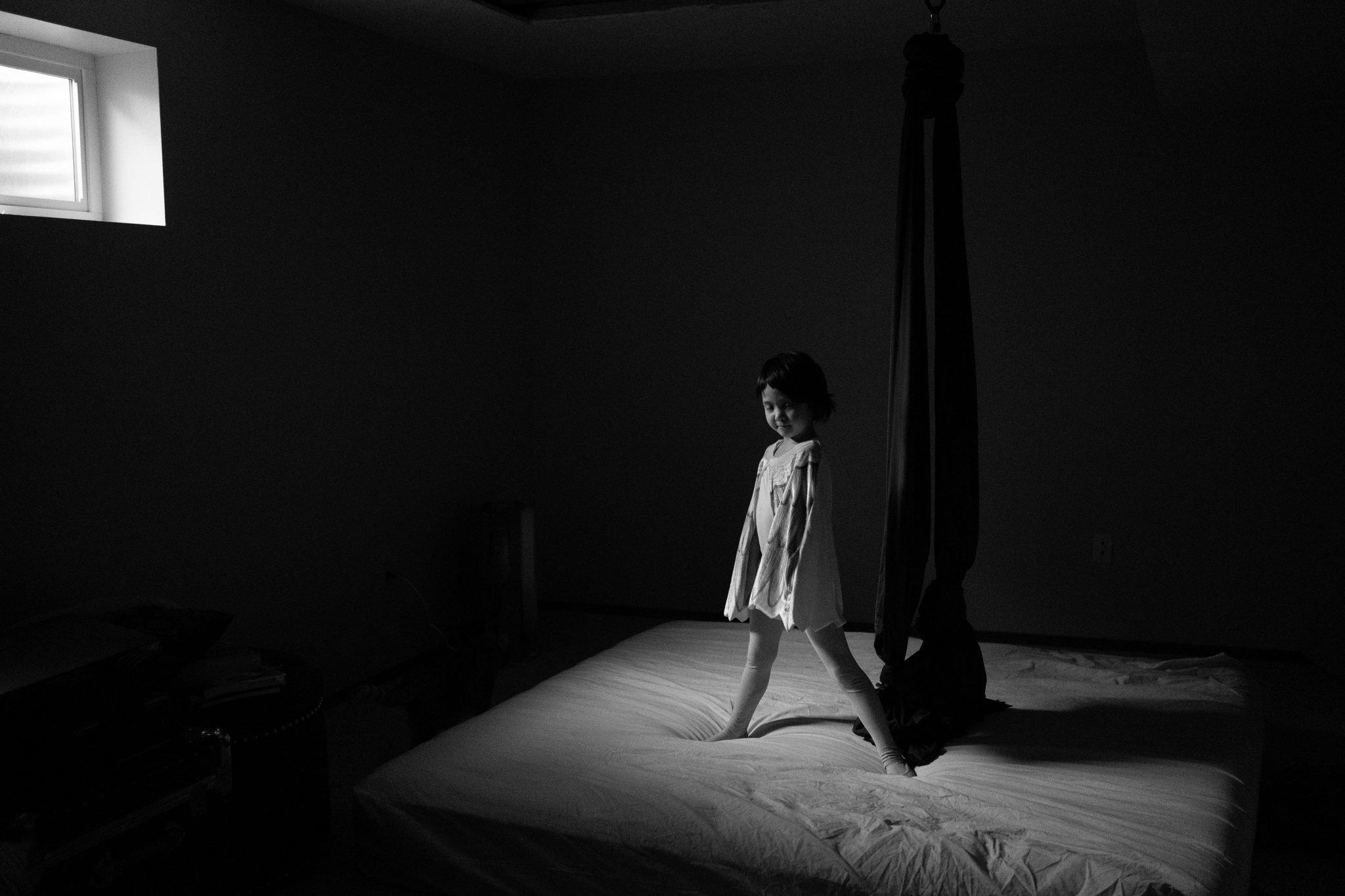 girl in light of window