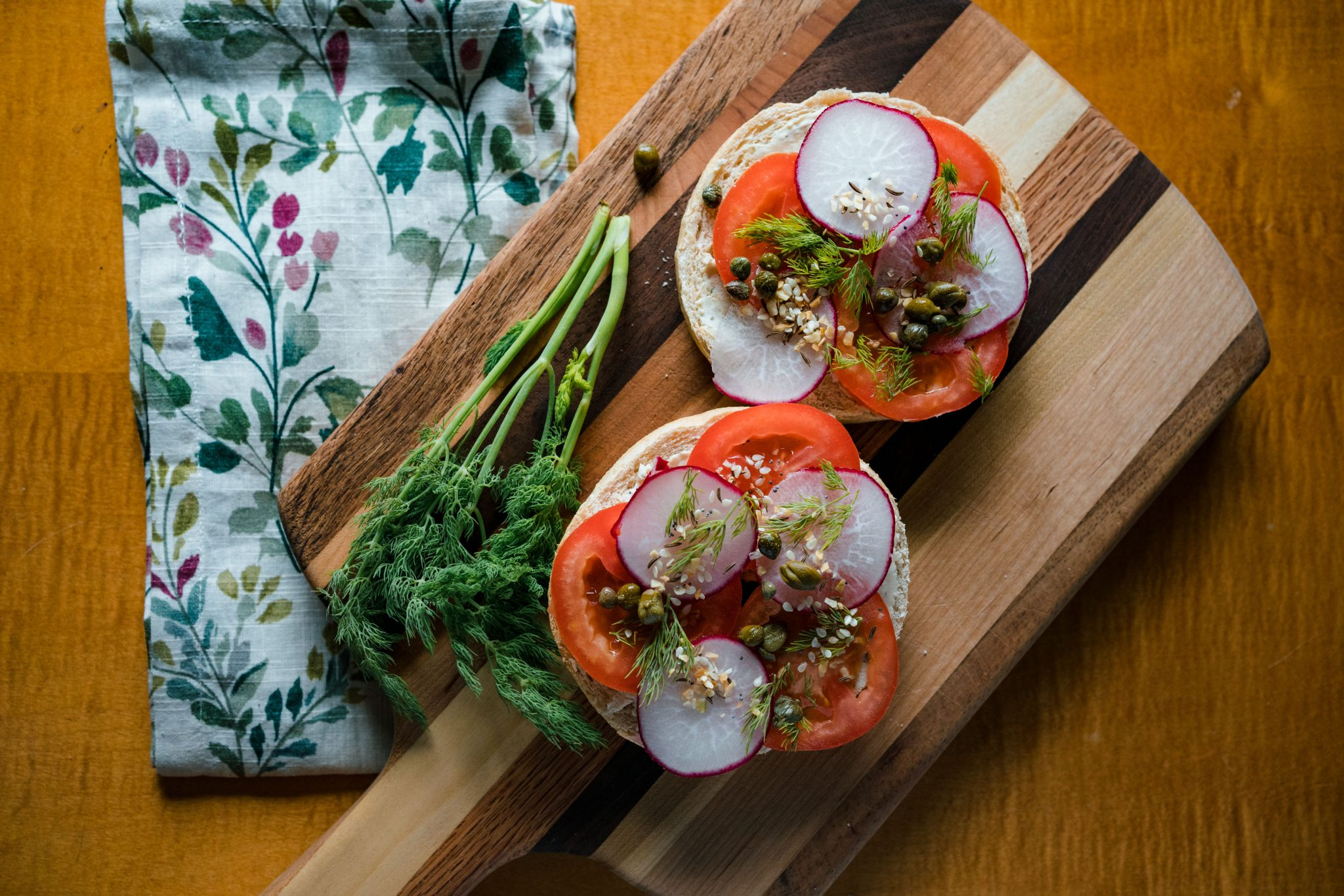 bagels with dill, capers, tomatoes and radish
