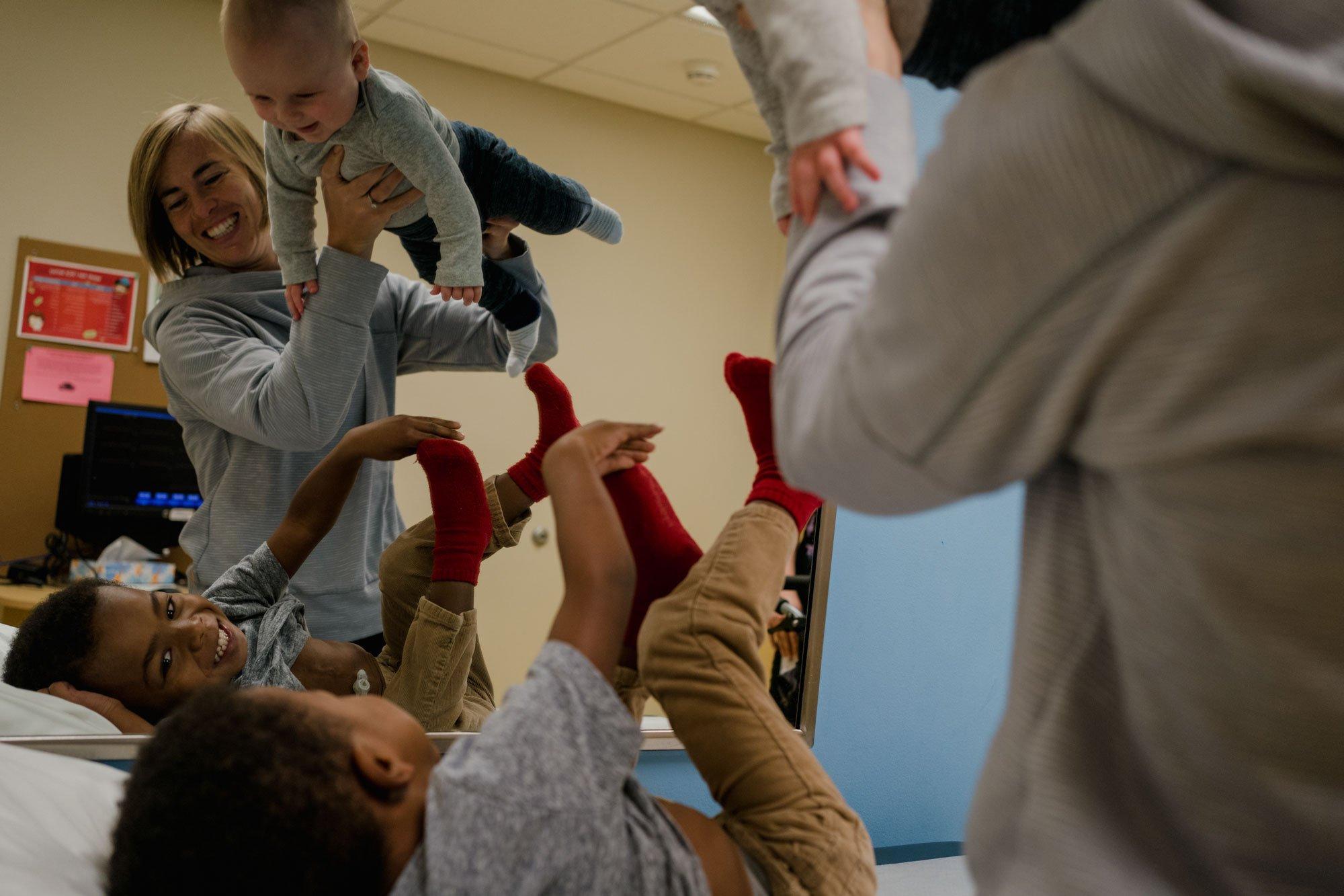 mom entertaining children at doctors