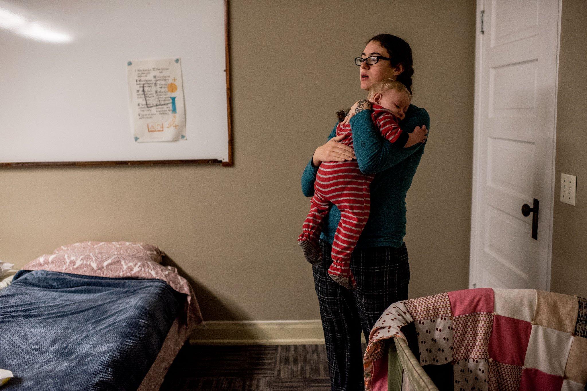 mom holding baby at night