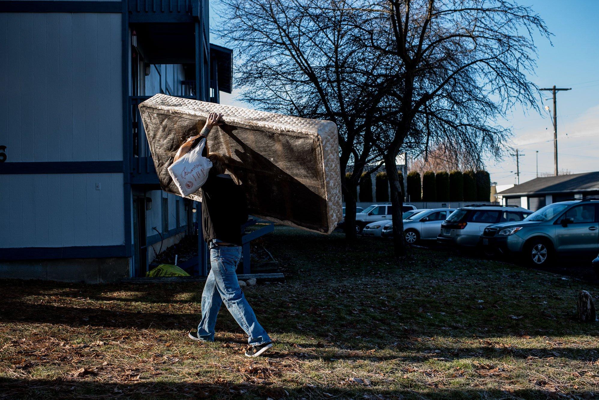 dad carrying mattress
