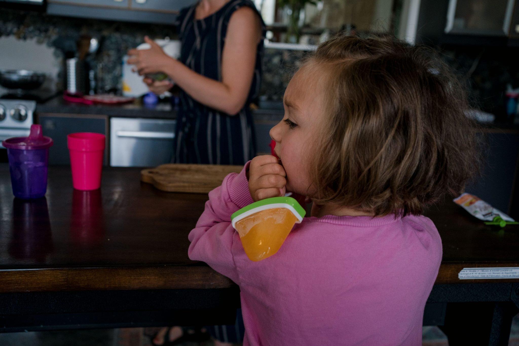daughter with popsicle melting on shoulder