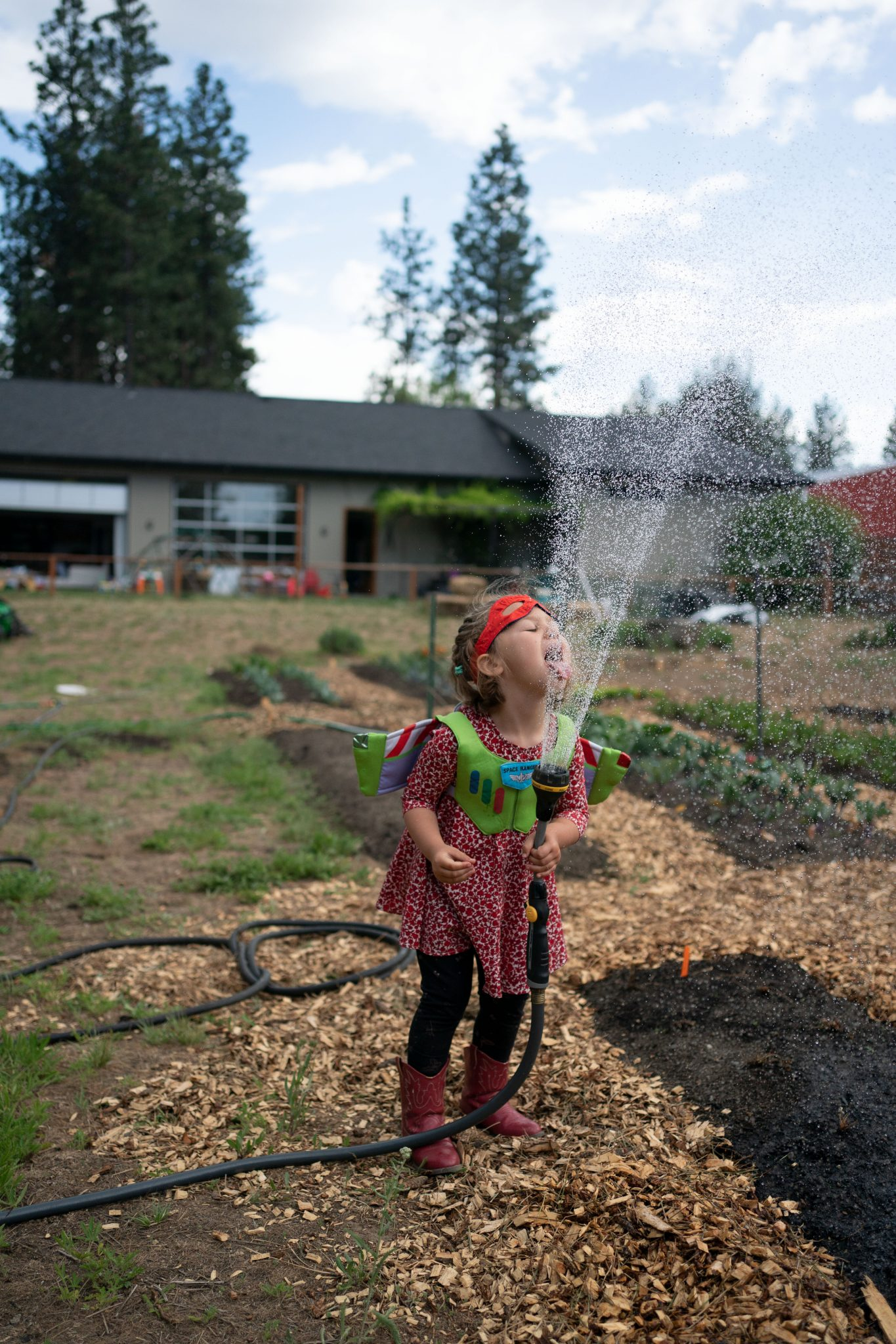 toddler drinking from hose