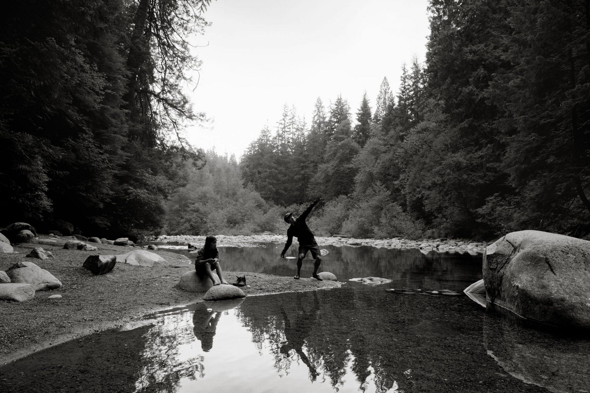 family skipping rocks