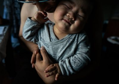 daddy cuddling reluctant baby