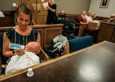 mom holding baby in adoption proceeding
